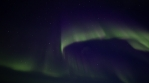 Colorful overhead Aurora Borealis corona on dark starry sky