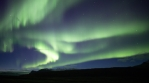 Full sky bright aurora borealis over mountain plain, Skaftafell Iceland