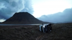 A vehicle lays toppled over after a high speed wind storm, bright.mov