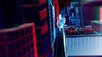 Geometric laser cityscape. Seamless neon retro futuristic animation with shallow depth of field.