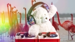 DJ Teddy Bear spinning with pink flamingos and rainbow lights