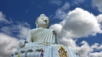Buddha and timelapse sky with clouds