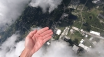 Skydiving - Hands through the clouds