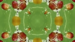 Red grape kaleidoscope. Red on green backdrop. Organic abstract psychedelic kaleidoscopic patterns.