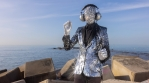 Mr disco man with sparkly face and headphones