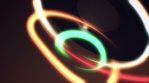 Multicolored light streak swirls over spinning vinyl record