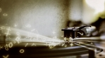 Turntable generating musical drum notes and light streaks