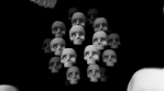 Seamless animation of skulls in black and white.