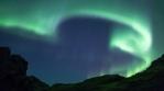 Bright aurora borealis rugged volcanic mountain terrain realistic Iceland 4k
