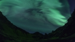 Bright aurora borealis steep mossy mountain canyon Iceland realistic 4k