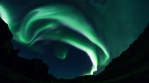 Extremely bright aurora borealis steep mountain canyon Iceland realistic 4k