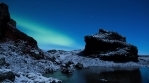 Iceland moon light snow covered volcanic landscape aurora borealis lake 4k