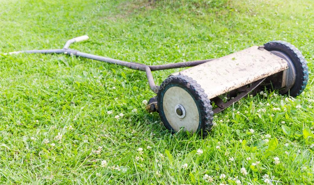 depositphotos_49737117-stock-photo-retro-manual-lawnmower