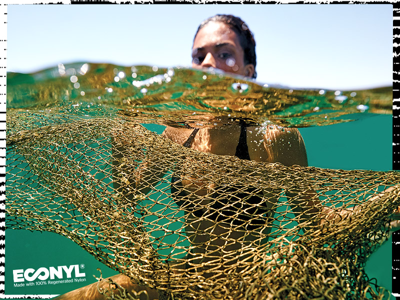 woman swimming with a fishing net