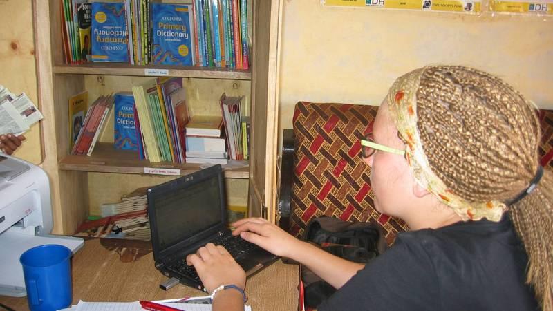 A volunteer doing office work.