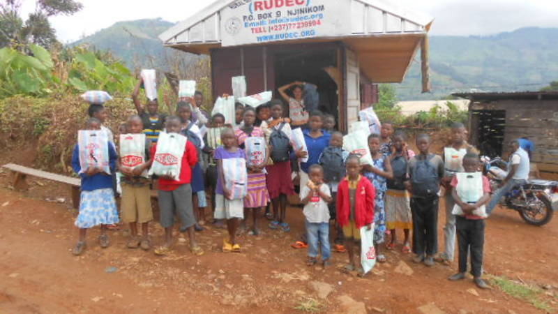 RUDEC office with orphans