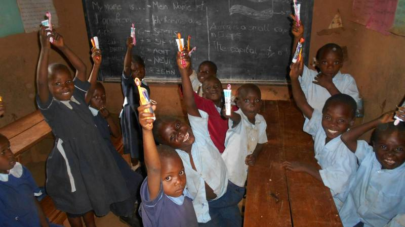 School pupils with presents froma volunteer