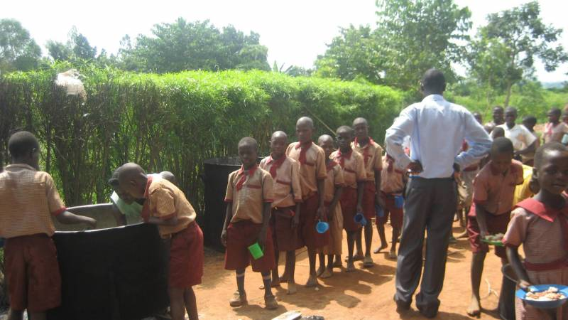 Children getting porridge during lunch time