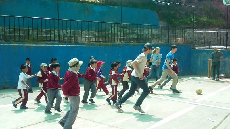Volunteers playing football (soccer)
