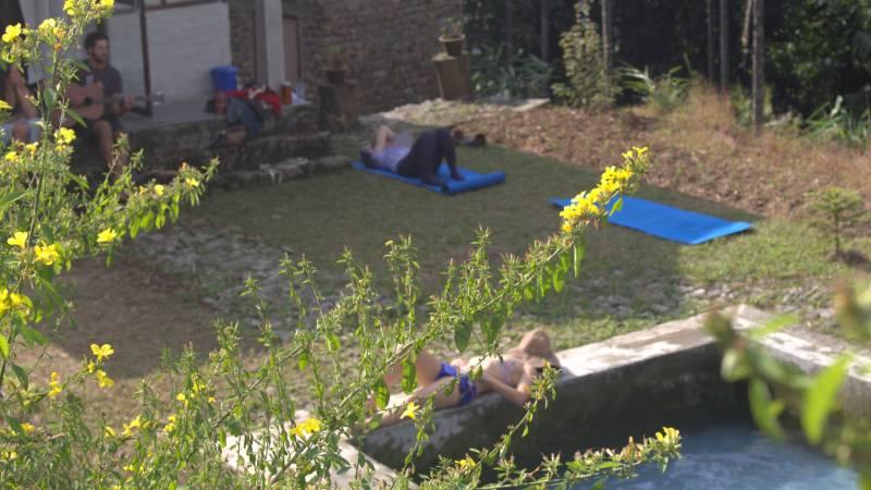 Volunteers take a break by the poolside