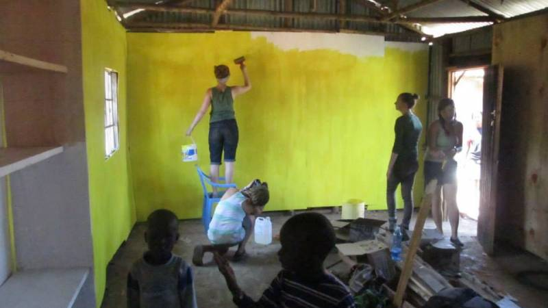 Past volunteers painting our community library i
