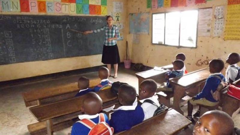 A volunteer teaching ( Silke)at our school