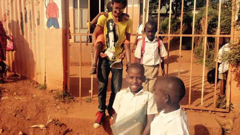 A volunteer with children during break time.