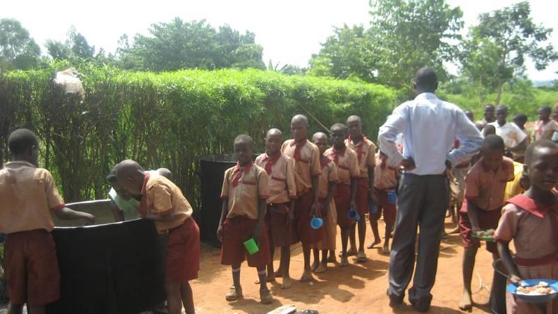 Children getting porridge during lunch time