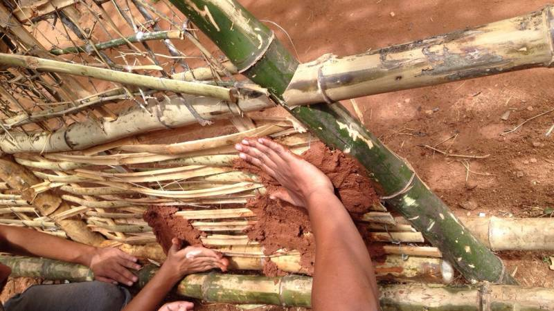 building traditional bamboo and earth homes