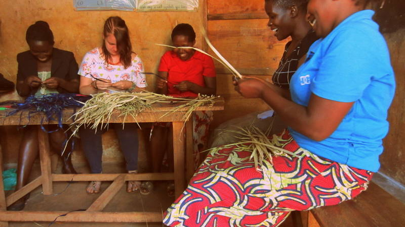 A volunteer learning how to make craft products.