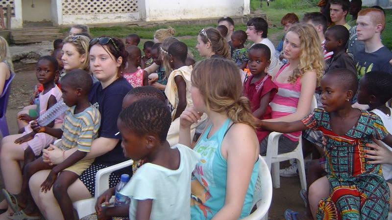 volunteers with school kids