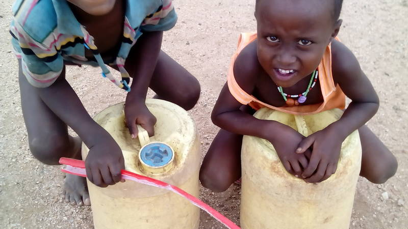 small children off to fetch water