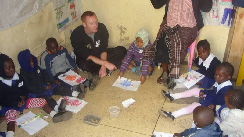 Volunteer teaching children