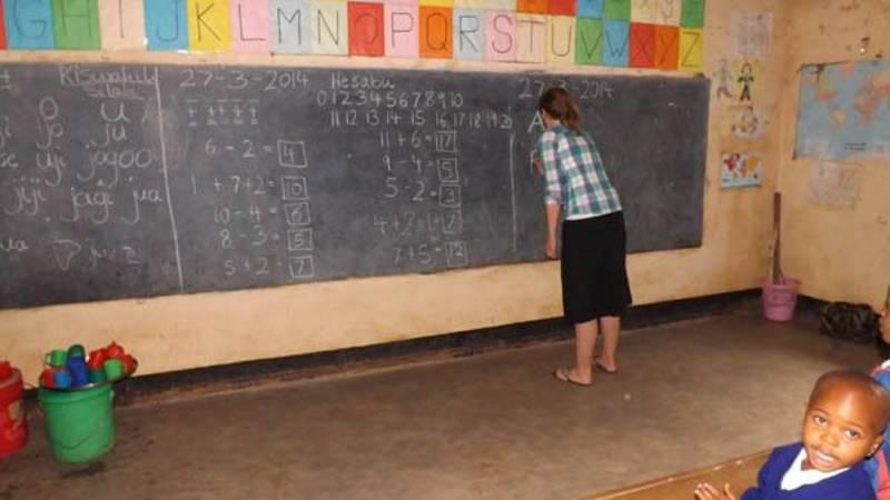 A volunteer teaching ( Silke) at our school