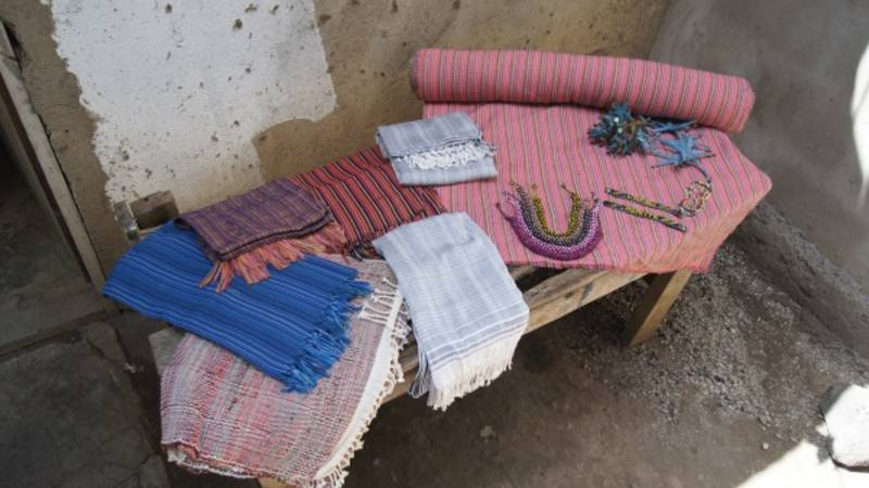 The woven scarfs, blankets and carpets