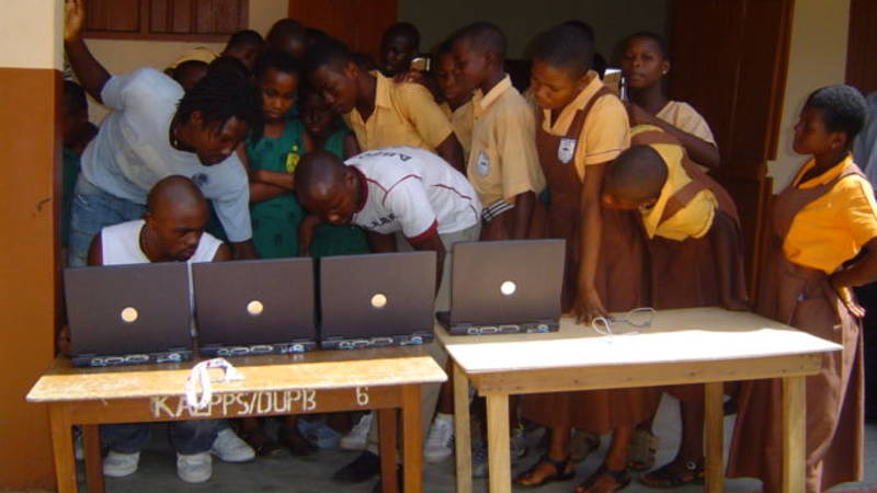 school kids learning computer skills