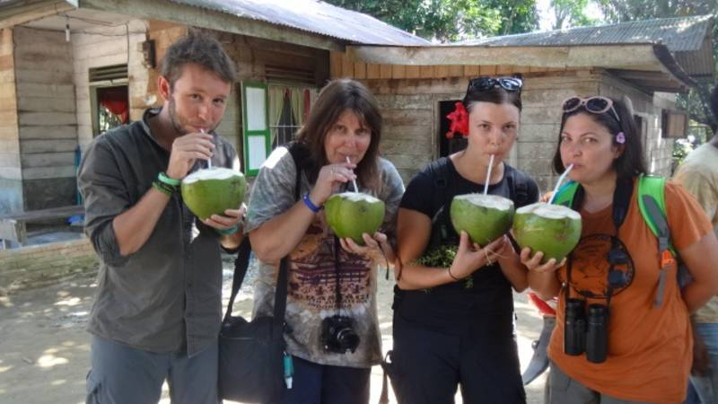 Enjoying  fresh  coconut drink on a village tour