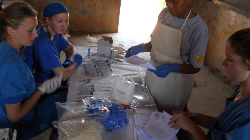 Volunteers assisting the Laboratory Technician