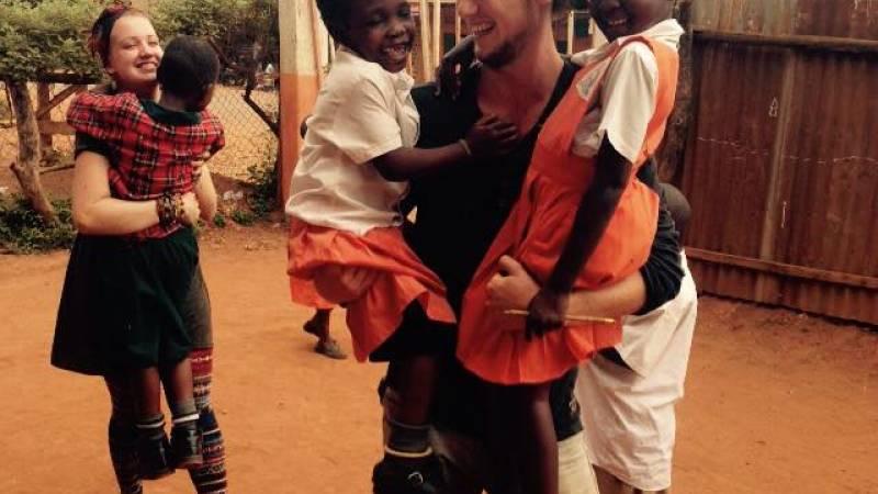 Volunteers interacting with children.