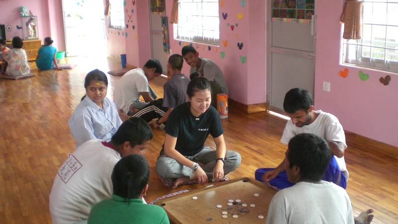 Volunteer playing with students