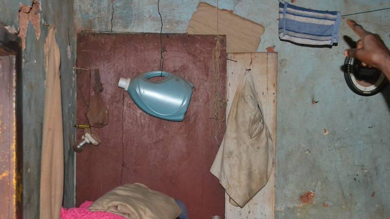 Room in need of repair - elderly woman