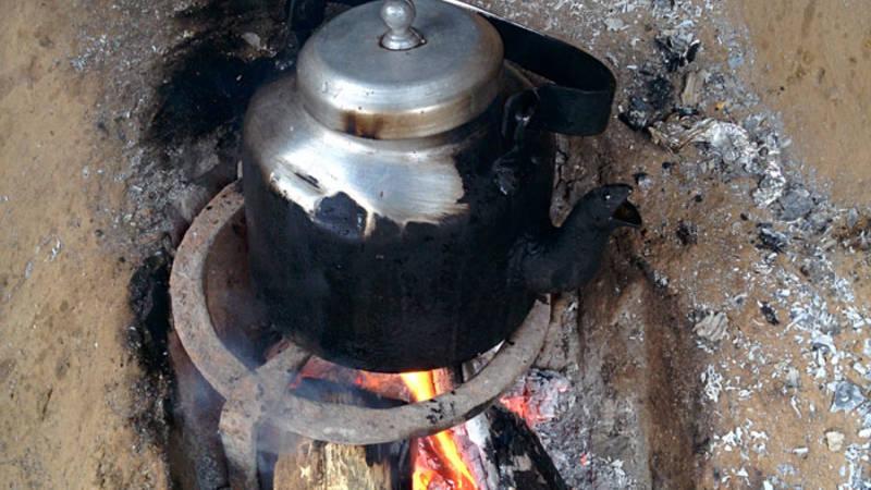 boiling tea in woods
