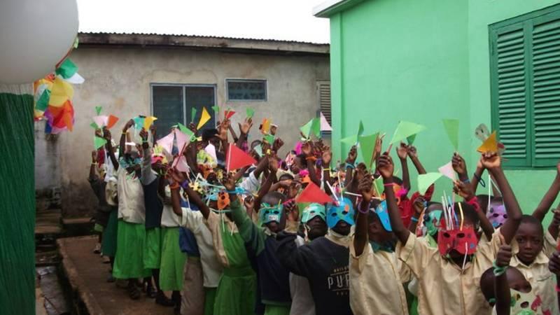 Volunteers throwing a party at school