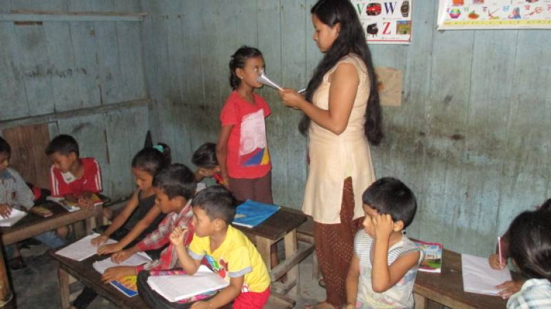 Local Volunteer Teacher and the children