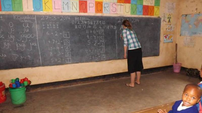 A volunteer teaching ( Silke) at our school