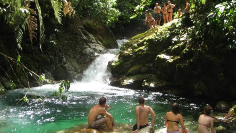 Volunteers swimming at our waterfall