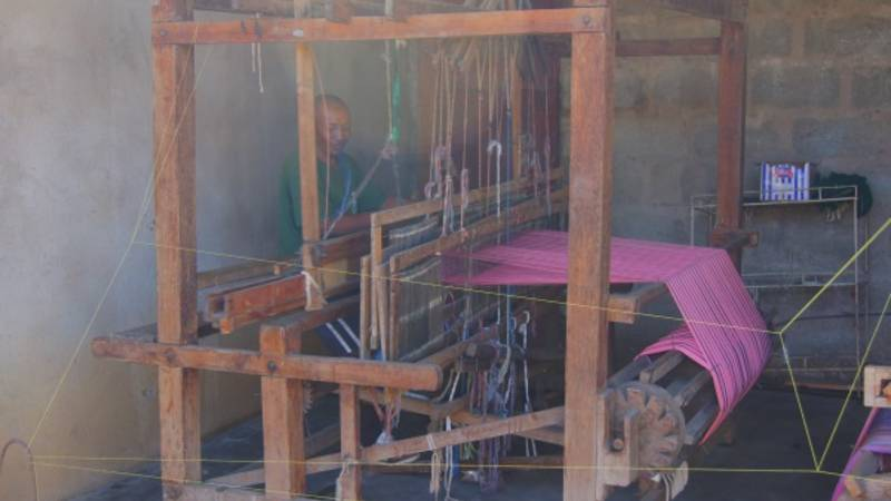One of the weavers at work