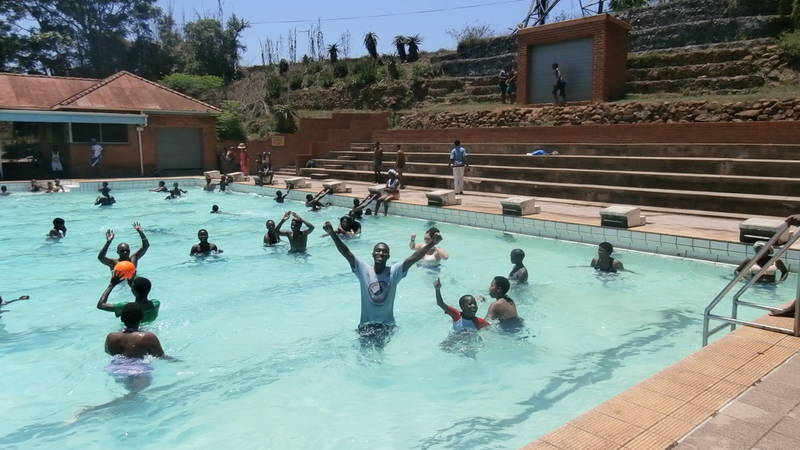 Street children having a swim at local school