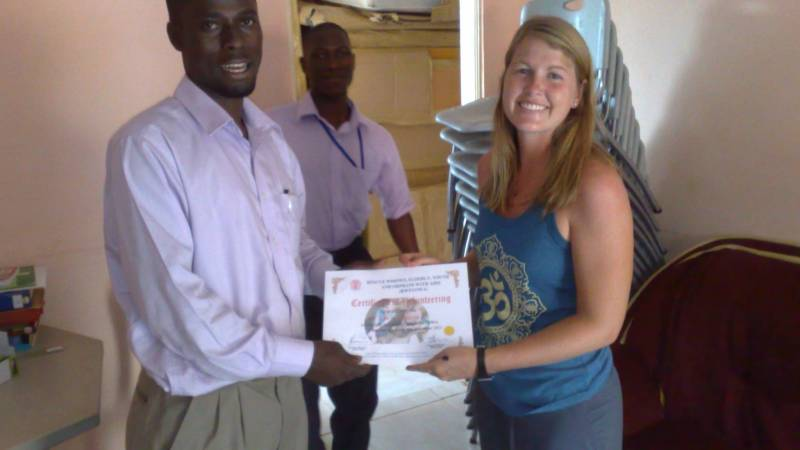 Volunteer recieving Certificate of Volunteering