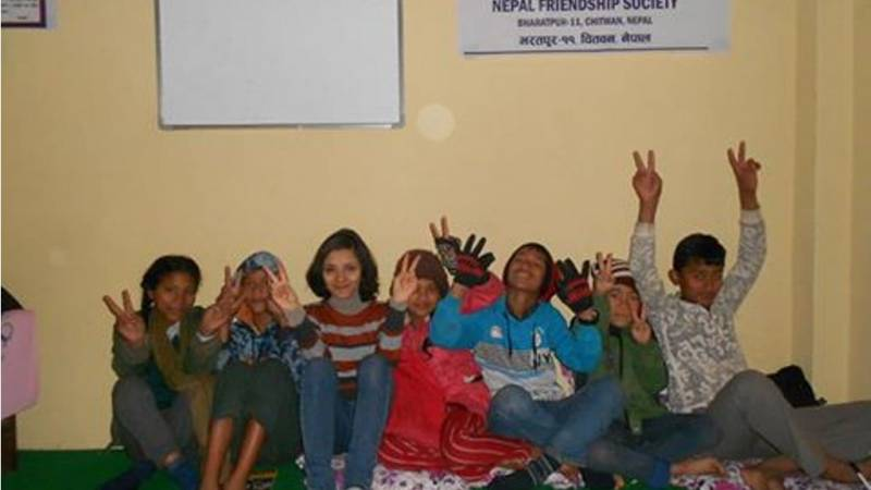 Learners with Volunteer teacher Angela.